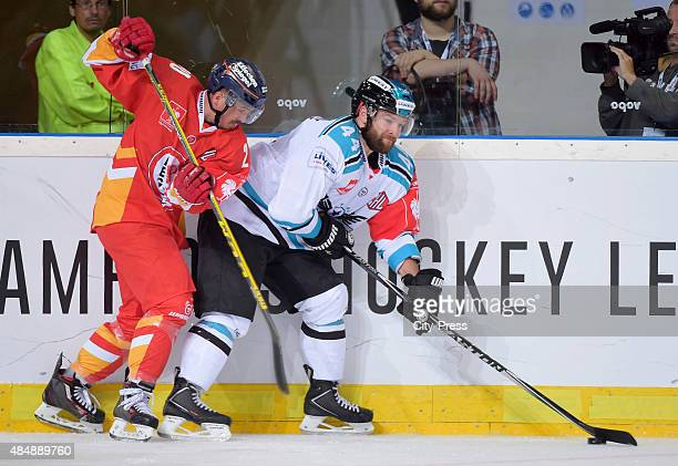 Olivier Latendresse of the Black Wings Linz handles the puck against Manuel Strodel of the Duesseldorfer EG during the game between Duesseldorfer EG...