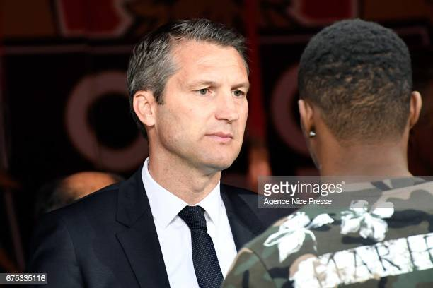 Olivier Letang director of PSG and Wylan Cyprien of Nice during the French Ligue 1 match between Nice and Paris Saint Germain at Allianz Riviera on...