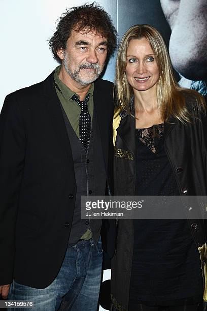 Olivier Marchal and his wife Catherine attend 'Les Lyonnais' Paris premiere at Drugstore Publicis on November 27 2011 in Paris France