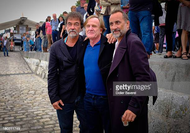 Olivier Marshal Quentin Raspail and Antoine Dulery pose during the photocall of 'Vaugand' at 15th Festival of TV Fiction on September 13 2013 in La...