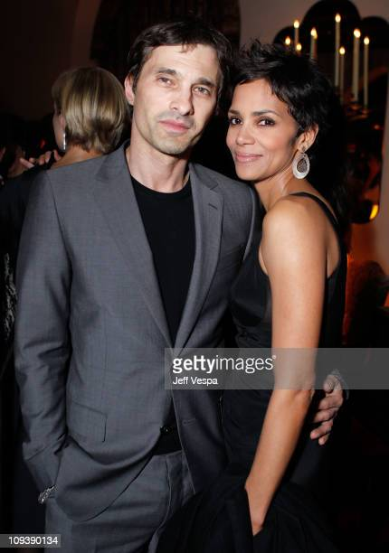 Olivier Martinez and actress Halle Berry attend Harvey Weinstein and Dior's Oscar Dinner at Chateau Marmont on February 23, 2011 in Los Angeles,...
