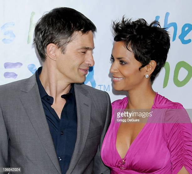 Olivier Martinez and Halle Berry arrive at the 31st Annual Silver Rose Gala & Auction held at the Beverly Hills Hotel on April 17, 2011 in Beverly...