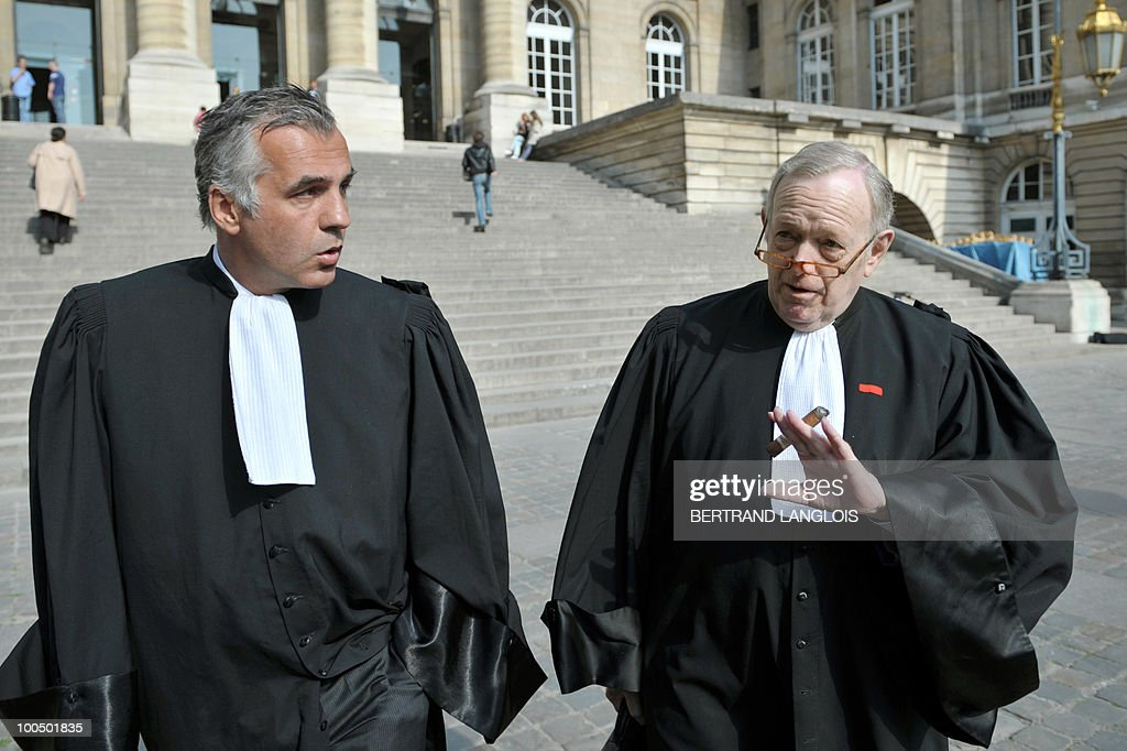 Olivier Metzner (R) and Yves Leberquier (L), lawyers of former Panamanian dictator Manuel Noriega addresses the media on April 27, 2010 outside Paris courthouse prior his client appears before a French judge to hear the charges against him. A plane carrying former Panama's strongman landed at Paris Charles de Gaulle airport shortly before 8:00 am (0600 GMT) today after the United States extradited him to face trial on charges of laundering drug money. Leberquier said he would challenge the French court's jurisdiction on the grounds that his client enjoys immunity as an ex-head of state and that the statute of limitations had run out.