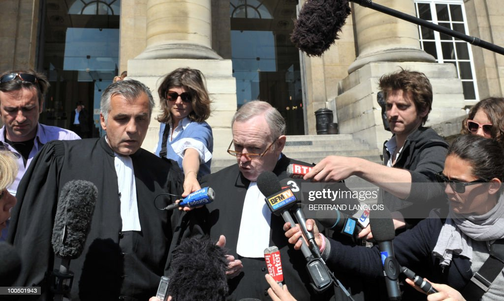 Olivier Metzner (C) and Yves Leberquier (L), lawyers of former Panamanian dictator Manuel Noriega addresses the media on April 27, 2010 outside Paris courthouse after his client appears before a French judge to hear the charges against him. A plane carrying former Panama's strongman landed at Paris Charles de Gaulle airport shortly before 8:00 am (0600 GMT) today after the United States extradited him to face trial on charges of laundering drug money. Leberquier said he would challenge the French court's jurisdiction on the grounds that his client enjoys immunity as an ex-head of state and that the statute of limitations had run out.