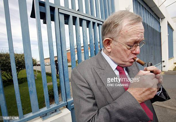 Olivier Metzner the lawyer of French rock singer Bertrand Cantat smokes in front of the detention center 20 September 2007 in Muret central France...