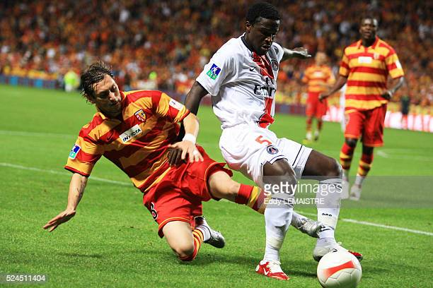 Olivier Monterubio tackles Bernard Mendy during the Ligue 1 soccer match between Racing Club de Lens and Paris Saint Germain