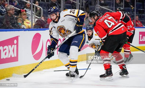 Olivier Nadeau of the Shawinigan Cataractes and Charle Truchon of the Quebec Remparts battle for the puck during their QMJHL hockey game at the...