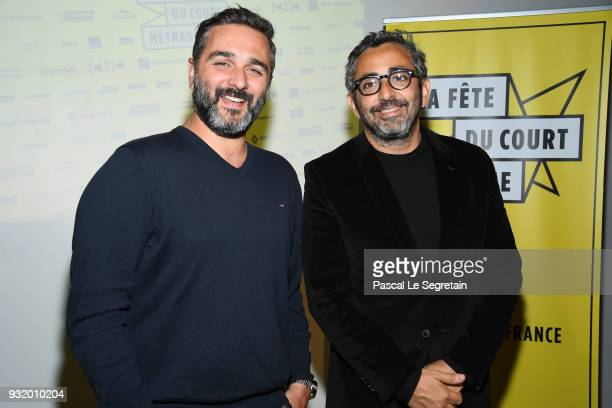 Olivier Nakache and Eric Toledano pose at 'La Fete Du Cour Metrage' Photocall on March 14 2018 in Paris France