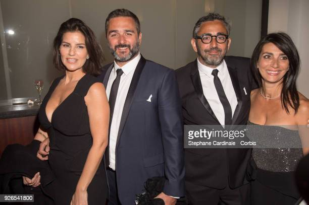 Olivier Nakache and wife with Eric Toledano and wife arrives at the Cesar Film Awards 2018 at Salle Pleyel on March 2 2018 in Paris France