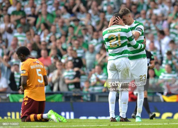 Olivier Ntcham and Mikael Lustig of Celtic celebrate on the final whistle during the Scottish Cup Final between Motherwell and Celtic at Hampden Park...