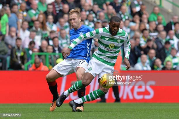 Olivier Ntcham of Celtic and Scott Arfield of Rangers battle for possession during the Scottish Premier League match between Celtic and Rangers at...