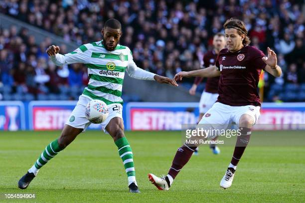 Olivier Ntcham of Celtic battles for possession with Peter Haring of Heart of Midlothian FC during the Betfred Scottish League Cup Semi Final between...