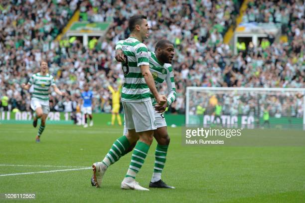 Olivier Ntcham of Celtic celebrates with teammate Tomas Rogic after scoring his team's first goal during the Scottish Premier League match between...