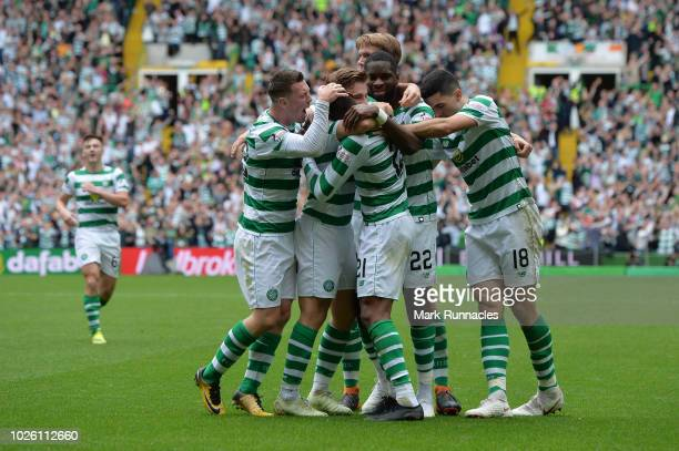 Olivier Ntcham of Celtic celebrates with teammates after scoring his team's first goal during the Scottish Premier League match between Celtic and...