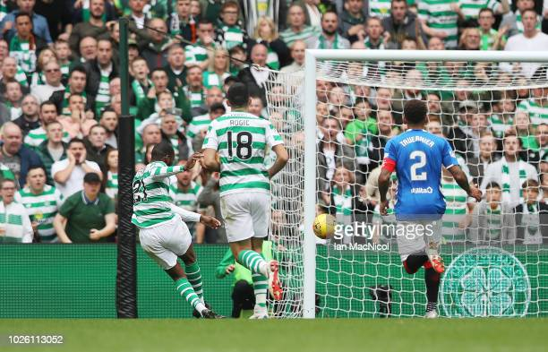 Olivier Ntcham of Celtic scores his team's opening goal the Scottish Premier League between Celtic and Rangers at Celtic Park Stadium on September 2...