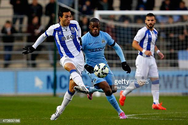 Olivier Ntcham of Manchester City in action with Tomas Podstawski of FC Porto during the Premier League International Cup Final match between...