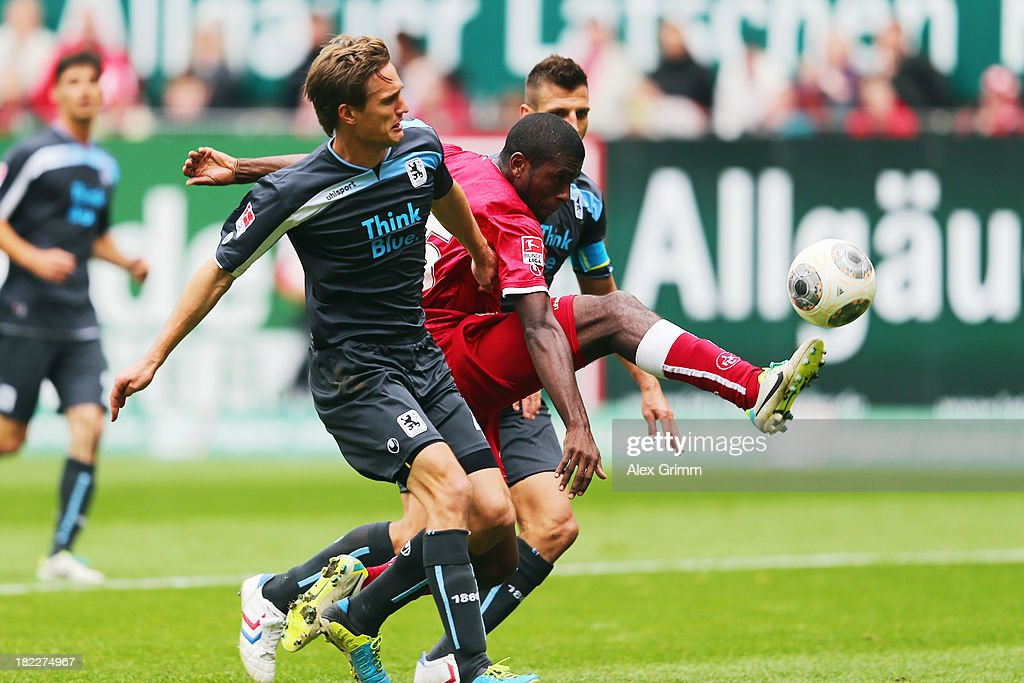 Olivier Occean (C) of Kaiserslautern is challenged by Kai Buelow (front) and Guillermo Vallori of Muenchen during the Second Bundesliga match between 1. FC Kaiserslautern and TSV 1860 Muenchen at Fritz-Walter-Stadion on September 29, 2013 in Kaiserslautern, Germany.