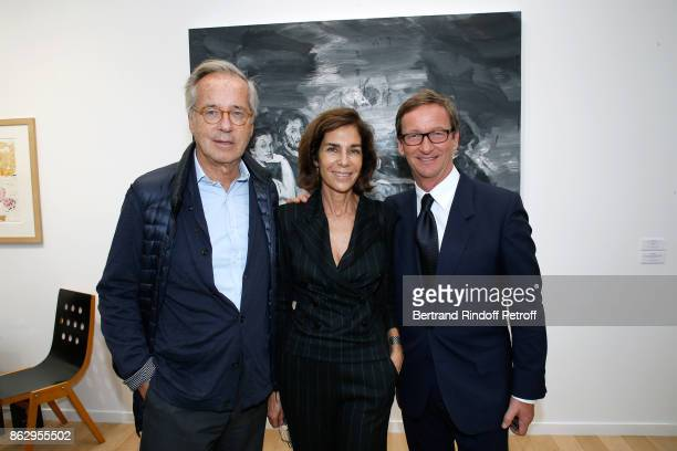 Olivier Orban his wife Christine and Thaddaeus Ropac attend the FIAC 2017 International Contemporary Art Fair Press Preview at Le Grand Palais on...