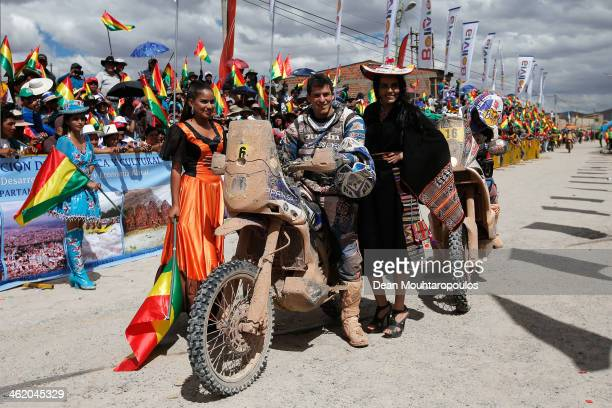 Olivier Pain of France on the Yamaha Factory Racing poses with some local girls before he makes his way to the podium during Day 8 of the 2014 Dakar...