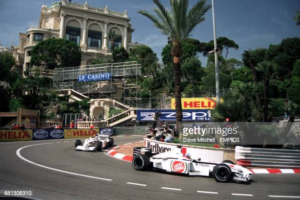 Olivier Panis leads teammate Jacques Villeneuve around the Loew's Hotel hairpin