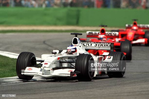 Olivier Panis leads the two Ferraris