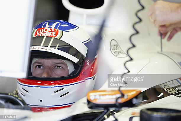 Olivier Panis of France and BAR Honda checks his lap times during first timed practice for the Formula One German Grand Prix at Hockenheim Circuit...