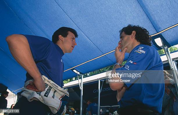 Olivier Panis of France driver of the Gauloises Prost Peugeot Prost AP02 Peugeot A18 V10 talking with team principal Alain Prost during practice for...