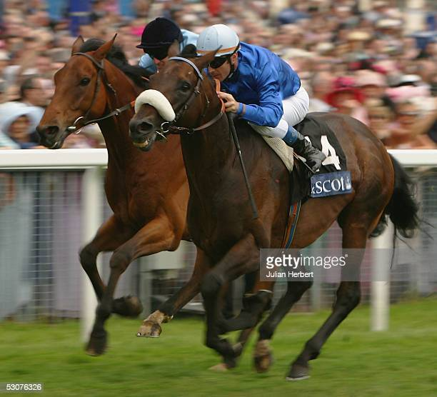 Olivier Peslier and Westerner get the better of the Johnny Murtagh ridden Distinction to land The Gold Cup Race run at York Racecourse on June 16...