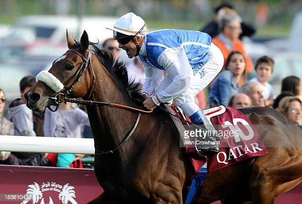 Olivier Peslier riding Solemia win the Qatar Prix de L'Arc de Triomphe at Longchamp racecourse on October 07 2012 in Paris France