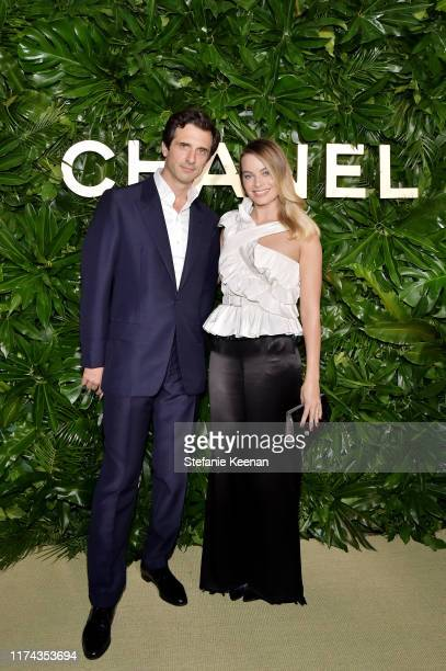 Olivier Polge and Margot Robbie wearing CHANEL attend Chanel Dinner Celebrating Gabrielle Chanel Essence with Margot Robbie on September 12 2019 in...