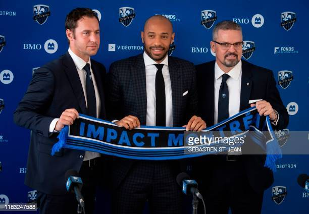 Olivier Renard, Sporting Director,Thierry Henry, and Kevin Gilmore, President & Chief Executive Officer hold a scarf as The Montreal Impact invites...