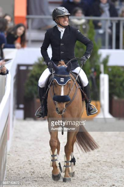 Olivier Robert of France on Tempo de Paban reacts after competing during the Saut Hermes at Le Grand Palais on March 18 2018 in Paris France