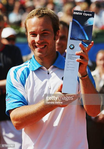 Olivier Rochus of Belgium poses fora photo after winning the final against Kristof Vliegen of Belgium during the BMW Open at the Iphitos tennis club...