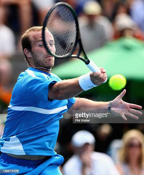 Olivier Rochus of Belguim plays a shot in his match against David Ferrer of Spain during day six of the 2012 Heineken Open at ASB Tennis Centre on...