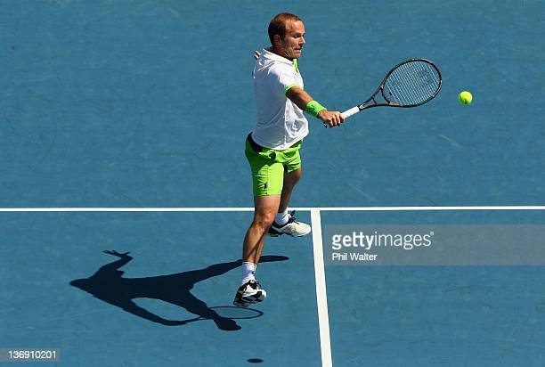 Olivier Rochus of Belguim plays a shot in his singles match against Philipp Kohlschreiber of Germany during day five of the 2012 Heineken Open at the...