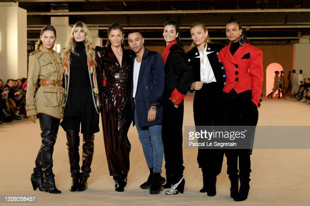 Olivier Rousteing and Helena Christensen pose with other models after the Balmain show as part of the Paris Fashion Week Womenswear Fall/Winter...