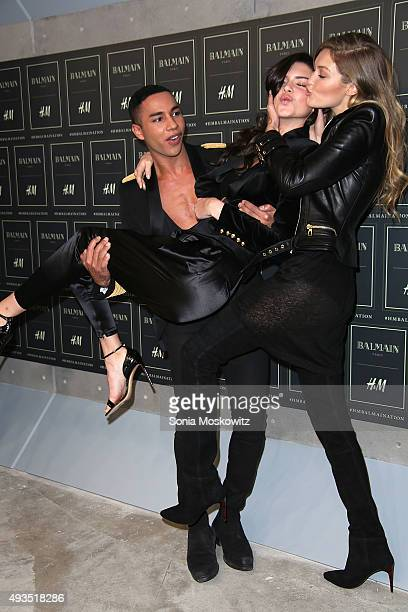 Olivier Rousteing Kendall Jenner and Gigi Hadid arrive at the BALMAIN X HM collection launch event at 23 Wall Street on October 20 2015 in New York...