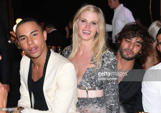 Olivier Rousteing Lara Stone and Marlon Teixeira at the amfAR Gala Cannes 2017 at Hotel du CapEdenRoc on May 25 2017 in Cap d'Antibes France