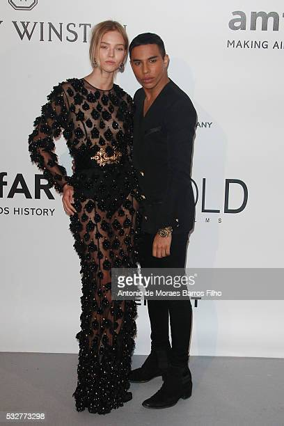 Olivier Rousteing Sasha Luss attend amfAR's 23rd Cinema Against AIDS Gala during The 69th Annual Cannes Film Festival on May 19 2016 in Cap d'Antibes...