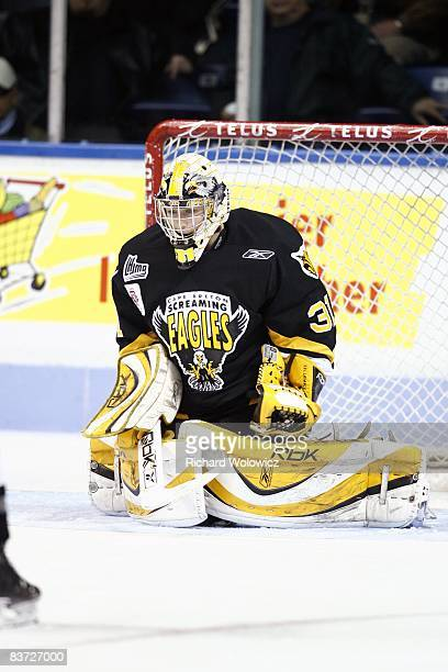 Olivier Roy of the Cape Breton Screaming Eagles stops the puck during the warm up period prior to facing the Quebec Remparts at the Colisee Pepsi on...