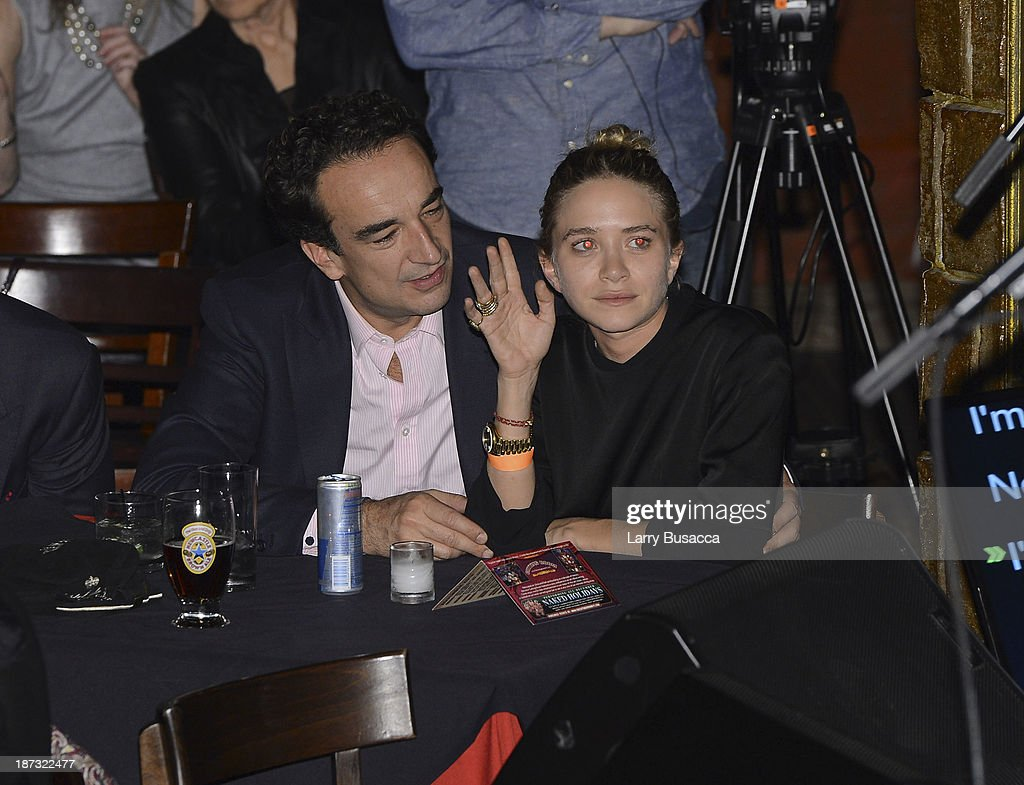 Olivier Sarkosy and Mary Kate Olsen attend performance of Ronnie Wood And Mick Taylor With Special Guests at The Cutting Room on November 7, 2013 in New York City. Ronnie Wood of the Rolling Stones made a rare club appearance at New York's premiere music venue and nightclub, The Cutting Room. Ronnie was performing the music of Jimmy Reed. Musical icons Mick Taylor, Al Cooper, Simon Kirk, Gary Clark Jr. and others joined him on stage.