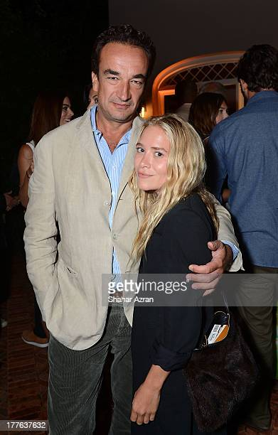 Olivier Sarkozy and Mary Kate Olsen attend 4th Annual Apollo In The Hamptons Benefit on August 24 2013 in East Hampton New York