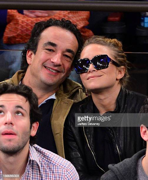 Olivier Sarkozy and MaryKate Olsen attend New York Knicks verse Indiana Pacers game at Madison Square Garden on November 18 2012 in New York City