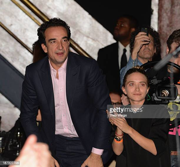 Olivier Sarkozy and MaryKate Olsen attend Ronnie Wood performing at The Cutting Room on November 7 2013 in New York City Ronnie Wood of the Rolling...