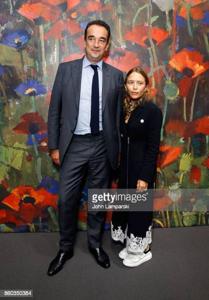 Olivier Sarkozy and MaryKate Olsen attend the 2017 Take Home A Nude Art Party and auction at Sotheby's on October 11 2017 in New York City