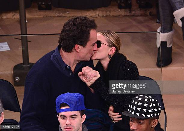 Olivier Sarkozy and MaryKate Olsen attend the Atlanta Hawks vs New York Knicks game at Madison Square Garden on December 14 2013 in New York City