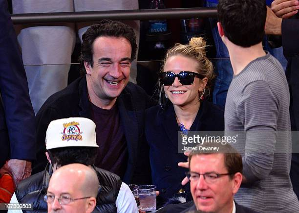 Olivier Sarkozy and MaryKate Olsen attend the Boston Celtics vs New York Knicks Playoff Game at Madison Square Garden on April 23 2013 in New York...