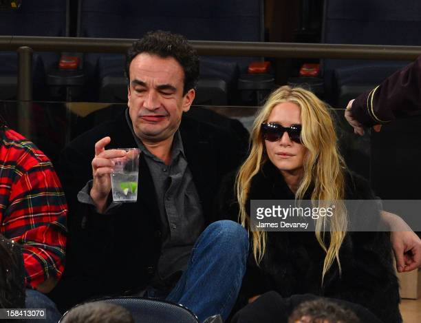 Olivier Sarkozy and MaryKate Olsen attend the Cleveland Cavaliers vs New York Knicks game at Madison Square Garden on December 15 2012 in New York...
