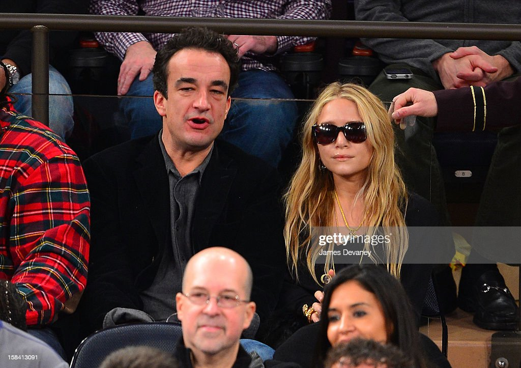 Olivier Sarkozy and Mary-Kate Olsen attend the Cleveland Cavaliers vs New York Knicks game at Madison Square Garden on December 15, 2012 in New York City.