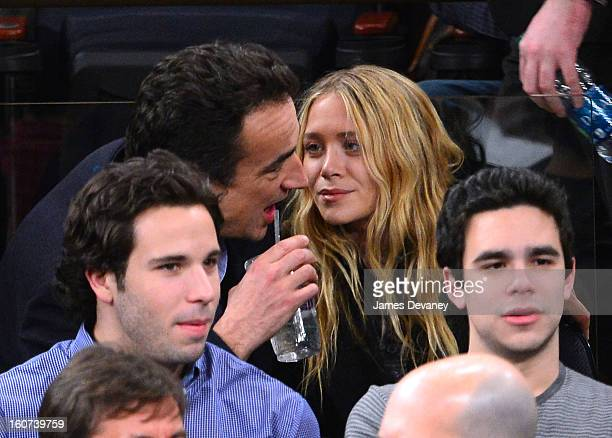 Olivier Sarkozy and MaryKate Olsen attend the Detroit Pistons vs New York Knicks game at Madison Square Garden on February 4 2013 in New York City